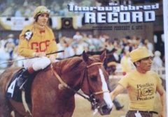 Eugene Roche leading Master Derby into the winner's circle for the 1975 Preakness Stakes. Provided by the Kentucky Racing Health and Welfare Fund.