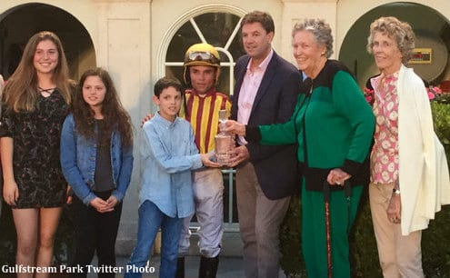 Isabelle de Tomaso (2nd from right in green) with her sister Hope Haskell Jones and trainer Graham Motion after the Holy Bull