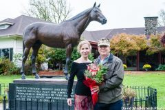 Laura Hillenbrand with Howard family historian, Col Michael C. Howard, U.S.M.C. (ret.) in front of life-size bronze Seabiscuit statue at historic Howard House- Ridgewood Ranch, Willits, CA  Col Michael Howard was a primary source for Laura Hillenbrand's best-seller, Seabiscuit; An American Legend